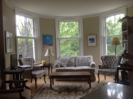 3 oversized opaque stained wooden hung windows