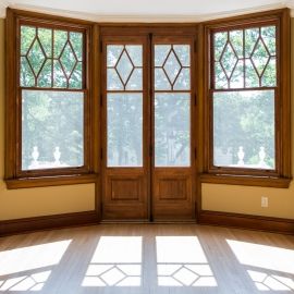 Balcony door with cremone bolt and 2 wooden double hung windows
