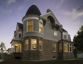 Wooden windows on Second Empire-style home with turret