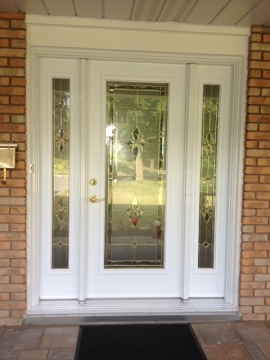 Steel door with 2 sidelites with stain glass in each of them