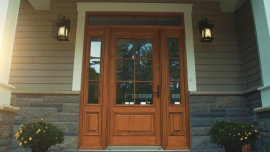 Wooden main entry door with 2 sidelites and a transom